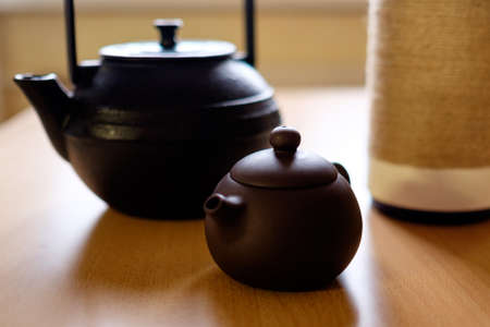 teapot: ?eramic and cast iron teapots on the table Stock Photo