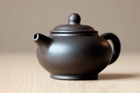 chinese teapot: Brown ceramic Chinese teapot on the table