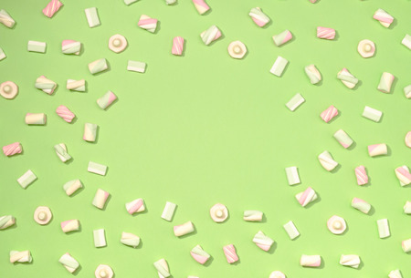 pallette: Frame of sweet marshmallows on pastel colorful background Stock Photo