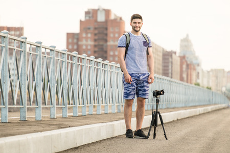 timelapse: Man with photo camera on tripod taking timelapse photos in the city Stock Photo