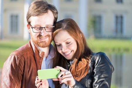 Young lovely couple doing selfie in spring sunny day