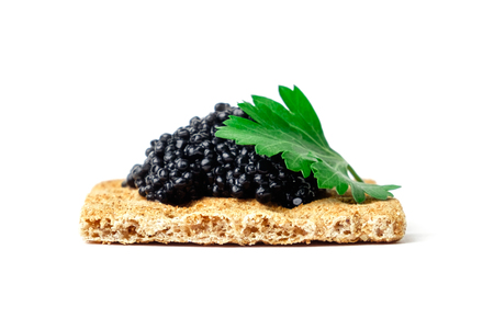 Snack with black caviar isolated on white background