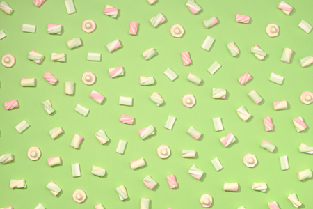 Sweet marshmallows minimalism set on pastel apple green color background Stock Photo
