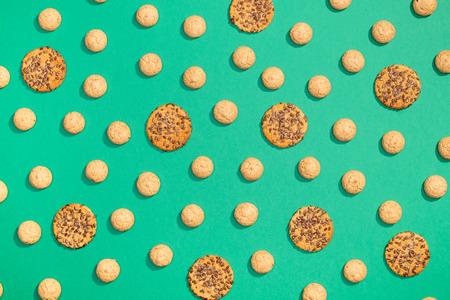Sweet cookies flat lay pattern on dark green background Stock Photo