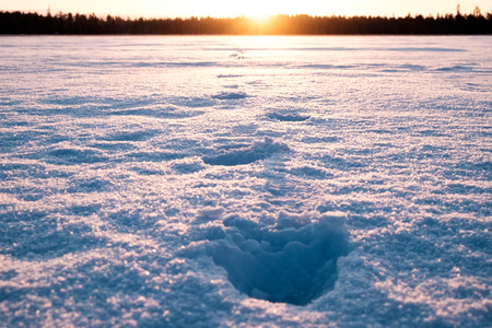 very cold: Man footprints on the snow on a very cold morning. Picture taken from low point of view on the lake. Vintage effect Stock Photo