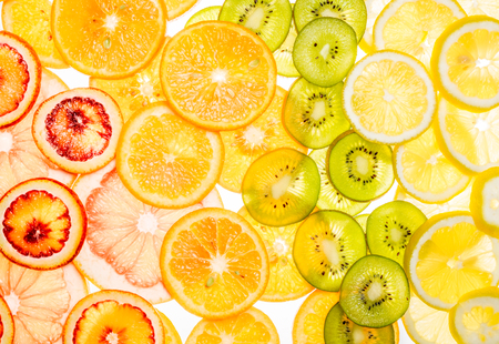 Bright sweet citrus slices. Juicy transparent fruit on white Stock Photo