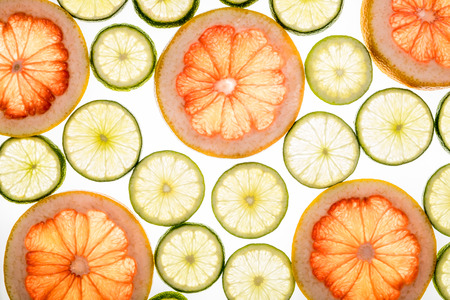 neon green: Bright lime and grapefruit slices. Juicy transparent fruit on white