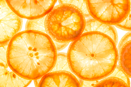 Mandarin citrus fruit slices background top view