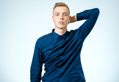 Portrait of a confident young man isolated white background