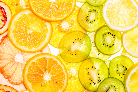 Beautiful fresh sliced mixed citrus fruits as background. Concept of healthy eating, dieting