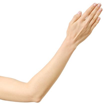 Uitgerekte hand van vrouw die op witte achtergrond wordt geïsoleerd