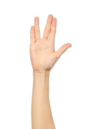 Female hand showing Vulcan Salute isolated on white