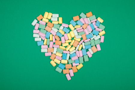 Heart shape of brightly colored chewing gum