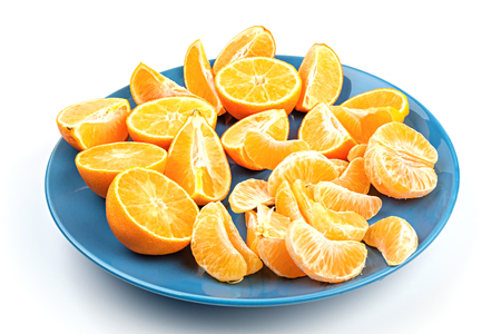 Fresh mandarins on a blue dish isolated on white background