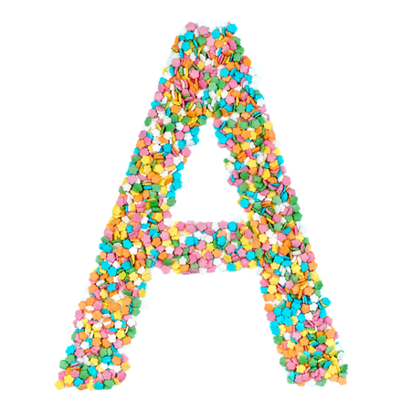 English alphabet letters, numerals and symbols made of little candies isolated on white background
