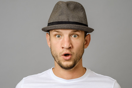 Young man amazed with news. Emotional guy expresses surprised. Facial expression Stock Photo