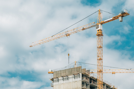 Building of multiroom inhabited highly floor house. Cranes on a construction site