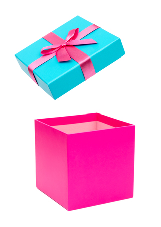 Open pink gift box with ribbon bow. Holiday present. Isolated on white background. Clipping path