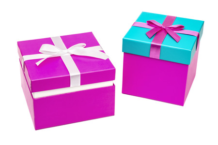 Two purple gift boxes with ribbon isolated on white background. Clipping path Stock Photo