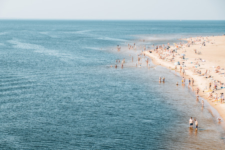 Crowded city beach at the summer day