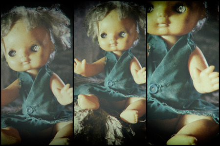 Ghost mystic doll smiling. Scary horror plastic doll without eyes