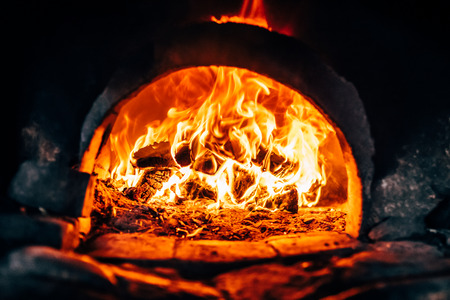 Firewood burning at the furnace close up