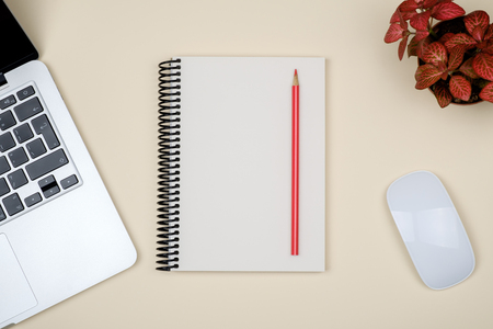 Minimal workplace with laptop and blank notepad on colored background. Top view. Flat lay Stock Photo
