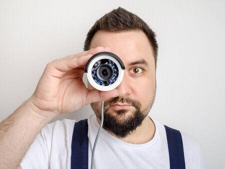 Fun CCTV installer looking through camera