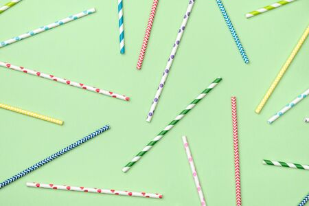 Abstract background. Colorful striped and polka dot cocktail straws pattern