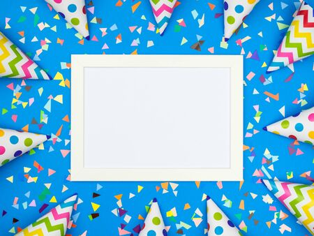 Blank card with different celebratory items on colorful background, top view