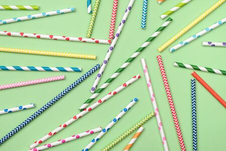 Background of colorful drinking cocktail straws. Top view