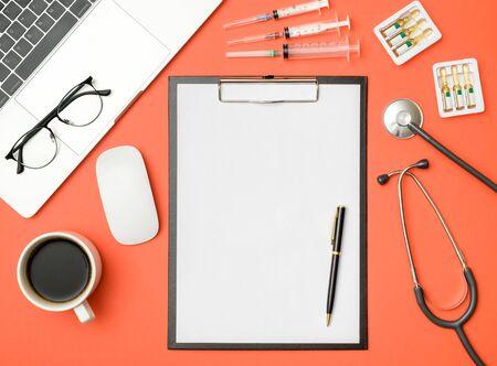 Modern medicine workplace with laptop at doctors desk Reklamní fotografie