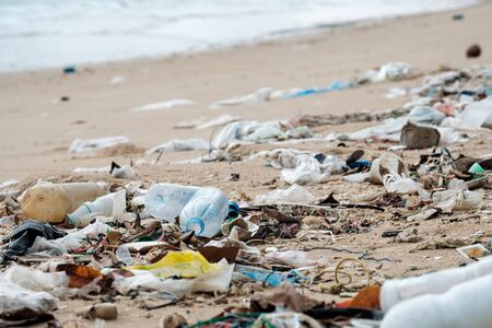 Beach pollution. Plastic bottles and other trash on the beach. Ecological problem
