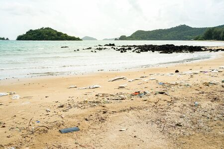 Beach pollution. Plastic bottles and other trash on sea beach. Ecological concept