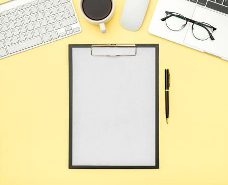 Minimal workplace with laptop and blank notepad on colored background. Top view. Flat lay Reklamní fotografie