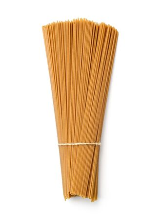 Tied uncooked buckwheat noodles isolated on white background. Traditional japanese noodles soba