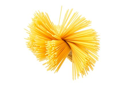 Spaghetti. Yellow pasta, ready for cooking. Isolated white background. Top view, flat lay Banque d'images