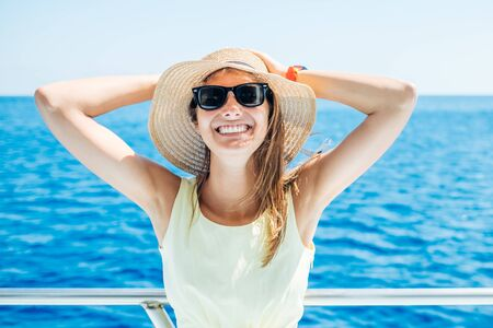 Young beautiful woman standing on the yacht. Luxury travel on the boat. Cruise vacation