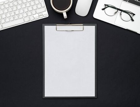 White designer office desk table with blank notebook page and laptop computer. Top view. Flat lay