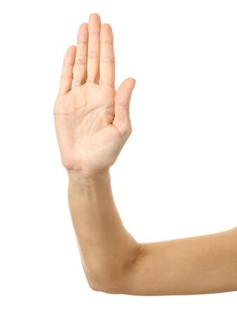 Stop it! Woman hand with french manicure gesturing isolated on white background. Part of series Stock Photo