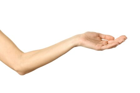 Outstretched female hand. Woman hand with french manicure gesturing isolated on white background. Part of series