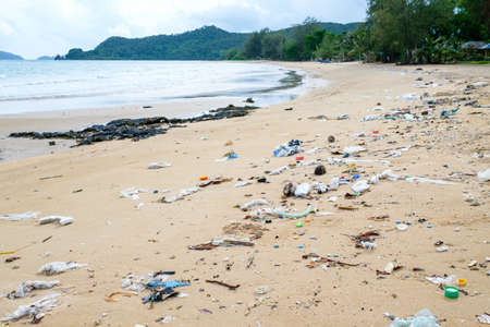 Spilled plastic garbage on the beach. Environmental pollution and ecological problem concept 写真素材