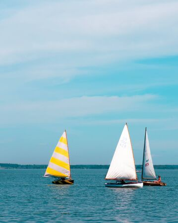 Three sailboats racing on the lake Stock Photo - 14016476