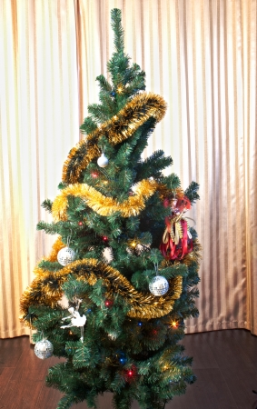 artificial lights: Decorated christmas tree in the room Stock Photo