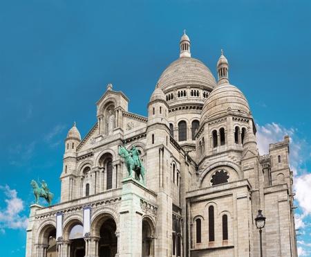 Sacre Coeur Basilica close-up, Paris, France  Bright blue sky photo