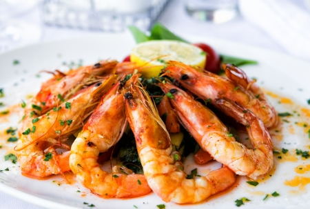 Fried shrimps on a plate with vegetables