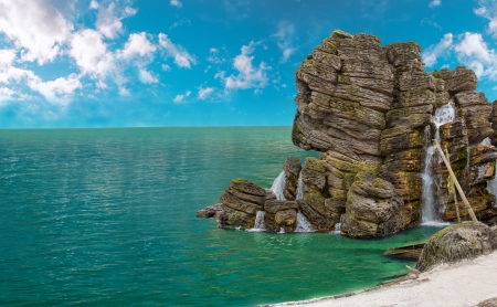 isla del tesoro: Enorme roca en forma de cráneo en la orilla del mar