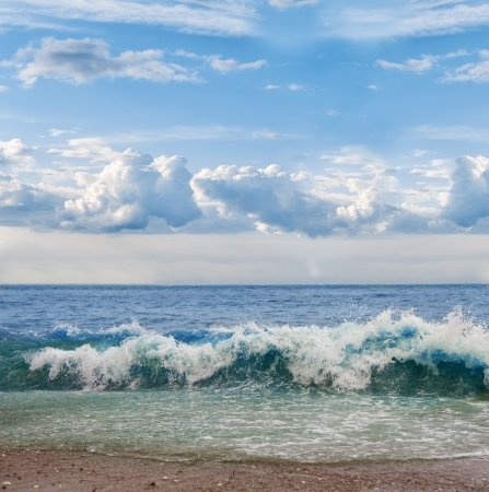 Ocean shore at windy day, big waves on the water photo