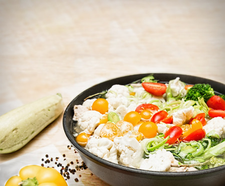 vegeterian: Colorful fresh stewed vegetables on pan. Food background. Vegeterian food background. With place for a text. Stock Photo