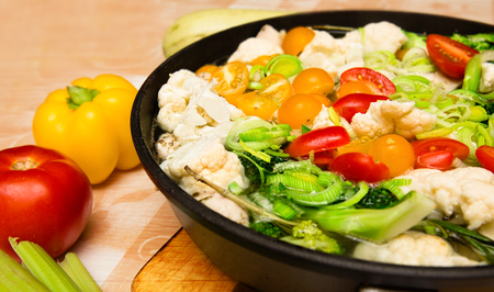 vegeterian: Colorful fresh stewed vegetables on pan. Food background. Vegeterian food background.
